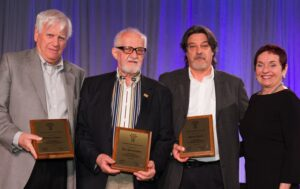 TREB members, from left, Arthur Caplan, Joe Panchyshyn and Mario Vitelli were presented with the David Rossi Committee Service Award by 2013-14 president Dianne Usher during Realtor Quest. (GP Photo)