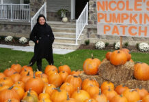 Nicole Beinert of Royal LePage Signature Realty poses in her pumpkin patch.
