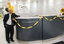 Virendra Srivastava poses in the lobby of his brokerage's new Mississauga office.