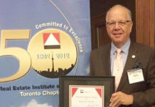 Barry Lebow was presented with the REIC Creative Writing Award for 2015