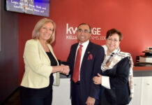 Penny MacKenzie, operating partner at Keller Williams Edge Realty, left, welcomes Tamer and Janet Fahmi to the firm.