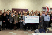 The team at Re/Max Centre City celebrates its $17,500 donation to London's Children's Hospital.