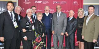U. Gary Charlwood, centre, accepted the award at the CFA National Convention in Ottawa.