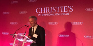 Chris Kapches, president and CEO of Chestnut Park Real Estate, accepts the award in Dublin.