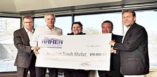 At the KAREA cheque presentation, from left: Adam Rayner, KAREA president; Mark Fisher; Jen Ducharme of the Kingston Youth Shelter; Ron Lakins; and Steve van Wynsberghe.