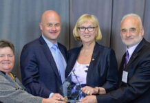 Celebrating the ACE Award, from left: Valerie Miles, director-at-large and government relations committee chair; Ray Ferris, president of OREA; Patricia Verge, immediate past-president of OREA; and Ettore Cardarelli, president-elect of OREA. (Photo: CPRS Toronto and Canadian Press Images)