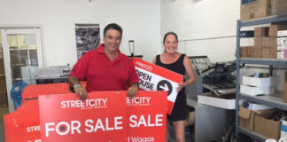 Costa Poulopoulos and Mary Johnson unveil the signs for their new brokerage, StreetCity Realty, which recently launched in London and Thunder Bay, Ont.