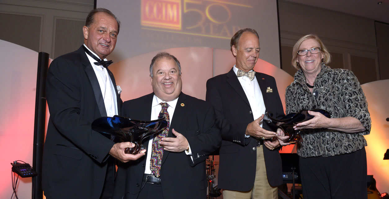 From left: 2016 CCIM Institute president Steven Moreira, Sandy Shindleman, Bruce Harvey and Susan J. Groeneveld, for whom the award is named.