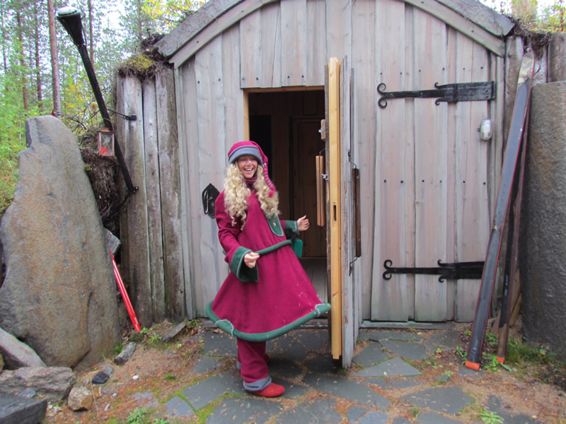 A kindly elf welcomes visitors to Santa's home in Finland.