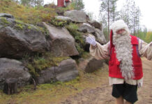Santa Claus welcomes us with open arms to his home (on left) in Finland.