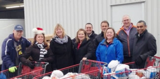 Kingston and area Realtors delivered more than 200 turkeys to the local food bank. From left: Tony Mader of the Partners in Mission Food Bank; and KAREA members Lisa Salamone, Kim Donaldson, Colleen Emmerson, Ted Lewis, Steve van Wynsberghe, Liza Tallen, John MacIntyre and Randy Gill.