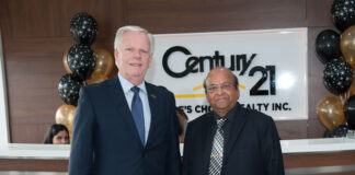 Brian Rushton, EVP of Century 21 Canada, with Virendra Srivastava, owner of Century 21 People's Choice Realty.