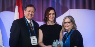 Ralph Fyfe, chair of the Canadian Realtors Care Foundation, and Amanda Rock, centre, REM's director of advertising and marketing, present the award to Laura-Leah Shaw.