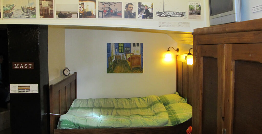 The interior of the houseboat, with a reproduction of a Van Gogh painting above the sleeping quarters