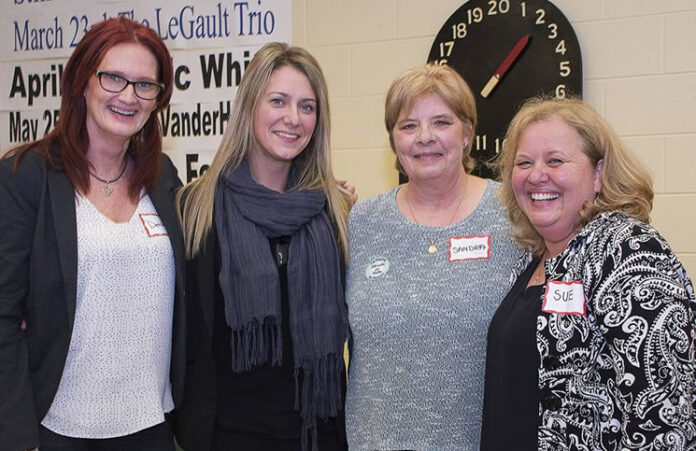 Royal LePage Frank Real Estate agents at their Euchre fundraiser. From left: Dena Sicard, Jane Thuet, Sandra McCormack (executive director, The Denise House) and Sue Driver.
