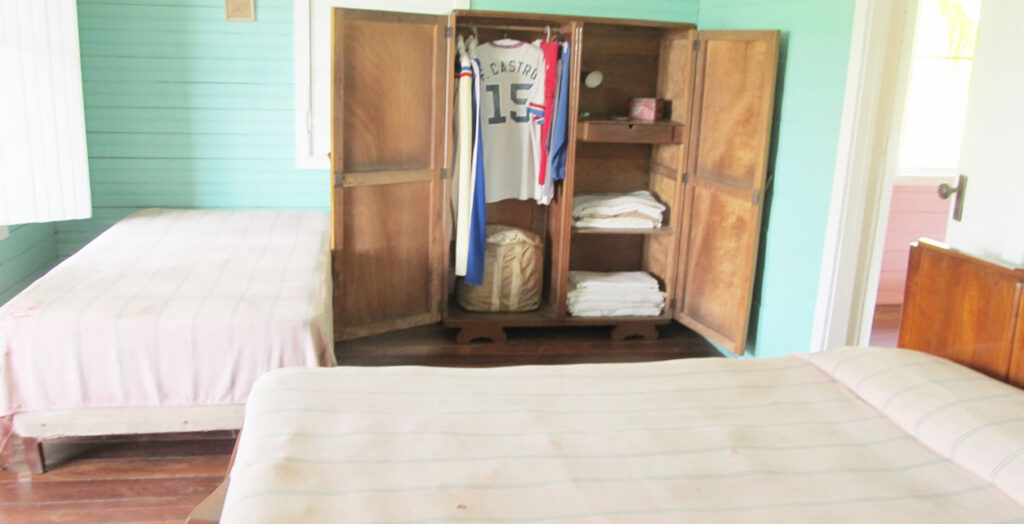Fidel's sports shirt with his name on the back hangs in the wardrobe of his former bedroom in the home where he grew up.
