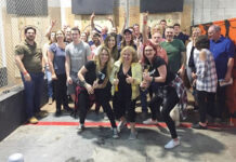 Royal LePage Frank Real Estate sales reps, from left, Jane Thuet, Sue Driver and Dena Sicard pose with guests at their axe-throwing fundraiser.