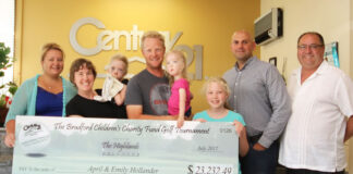 From left: Katherine Milian, manager at Century 21 Heritage Group in Bradford, presents the cheque to the Hollander family with sales reps Carlos Silva and Luis Moniz.