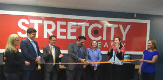 At the ribbon cutting ceremony at the StreetCity Kingston branch, from left: sales rep Caterina Salamone; Don Kottick, EVP of Peerage Realty Partners; Gavin Swartzman, CEO of Peerage; Costa Poulopoulos, president of StreetCity; Liza Tallen, manager at StreetCity's Kingston branch; Mary Johnson, VP of StreetCity; and Kendra Brennan.