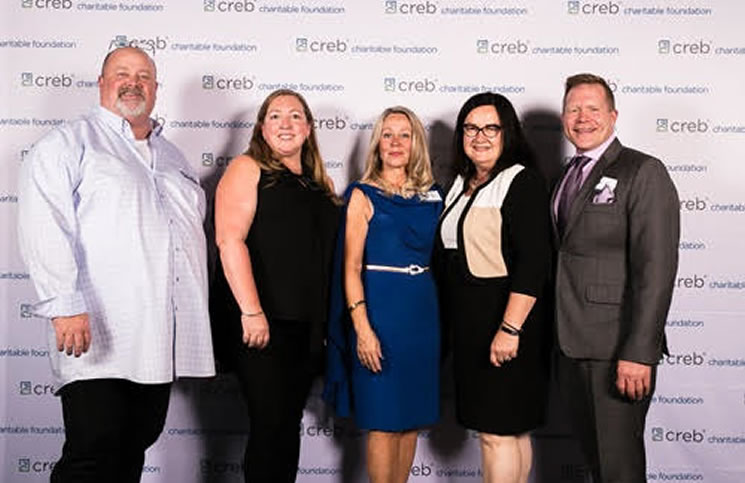 From left: Rob Campbell, Allyson Palaschuk from Made by Momma, Aneve MacKay-Lyons, Christine McIver of the Kids Cancer Care Foundation of Alberta and Abe Brown from Inn from the Cold.