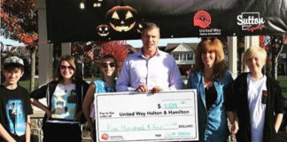 Cliff Barron and friends pose with the cheque for the United Way.
