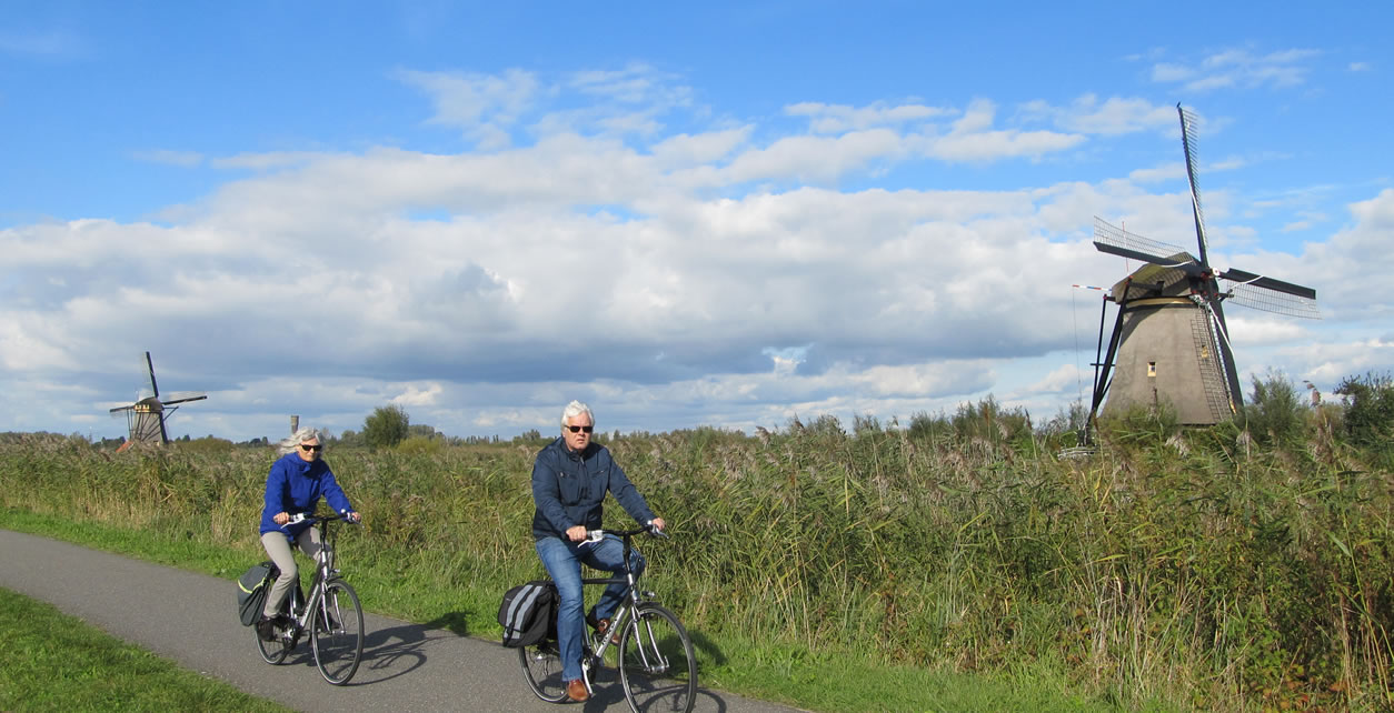 Visitors to Kinderdijk can walk or cycle along a path between the 19 windmills that are part of the UNESCO World Heritage Site.