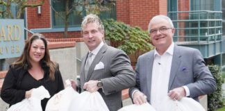 Real Estate Board of Greater Vancouver officers Jill Oudil, president; Phil Moore, president elect and Keith Liedtke, vice president, help with the Blanket Drive.