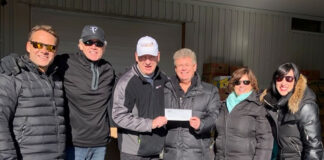 Members of the Kingston and Area Real Estate Association deliver turkeys and a cheque to the local food bank. From left: Steve van Wynsberghe, Mark Fisher, Tony Mader of Partners in Mission Food Bank, Dave Pinnell Jr., Shawna Stewart and Mary Ambrose.