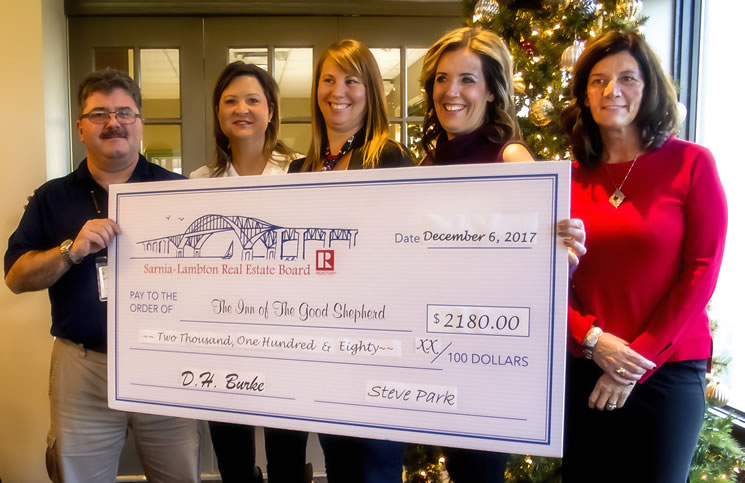 Myles Vanni, left, executive director of the Inn of the Good Shepherd, receives the cheque from Communication & Public Relations Committee members Kathy Murphy, Melanie Kelders, Amy Hayes and Missy Stephens.