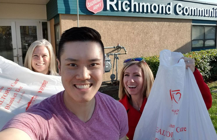 Volunteers Tina Gonzalez, Daniel John and Diana Dickey of Sutton Group - Seafair Realty in Richmond, B.C. take donations to the Richmond Salvation Army.
