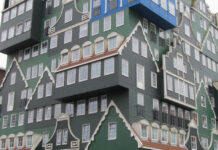 Inntel Hotel in Zaandam, Holland features the facades of houses in the region. Note the blue house in the top corner, an homage to impressionist painter Claude Monet.