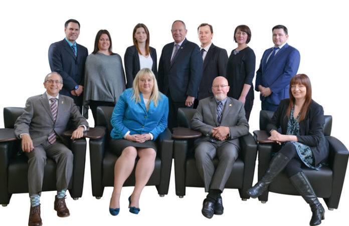 The 2018 Board of Directors of the Vancouver Island Real Estate Board. Back row, from left: Ray Francis, Sandy Rantz, Lovina Miller, Marty Douglas, Kevin Reid, Erica Kavanaugh and Chris Quinn. Front row: Executive officer Bill Benoit, Kaye Broens, Don McClintock and Janice Stromar. (Photo: Artez Photography)