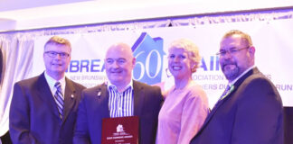 Lincoln Thompson and his spouse Donna Gardiner Thompson are flanked by Jamie Ryan, NBREA CEO, left and Robert Stewart, president of NBREA, right, at the NBREA awards presentation.
