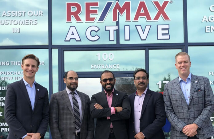 Opening the new Re/Max Active Realty offices, from left: John Dowbiggin, director franchise growth, Re/Max Integra; Ali Wahid, Addy Saeed and Umer Wahid, owners of Re/Max Active; and Christopher Alexander EVP, Re/Max Integra.