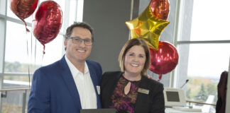 Andrew Galvin receives his award from PRHC Foundation CEO Lesley Heighway.