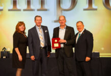 From left: Tami Bonnell, CEO, Exit Realty Corp. International, David Sawler and Philip Duplisea, owners, Exit Realty Advantage and Steve Morris, founder and chairman, Exit Realty Corp. International.