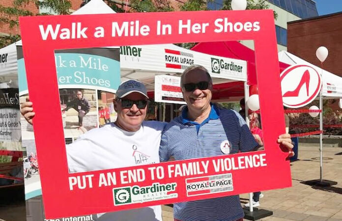 Walk a Mile in Her Shoes Fredericton organizer and Royal LePage Gardiner Realty broker/owner Lincoln Thompson is joined by fellow Royal LePager and Walk a Mile in Her Shoes Montreal organizer Georges Gaucher.