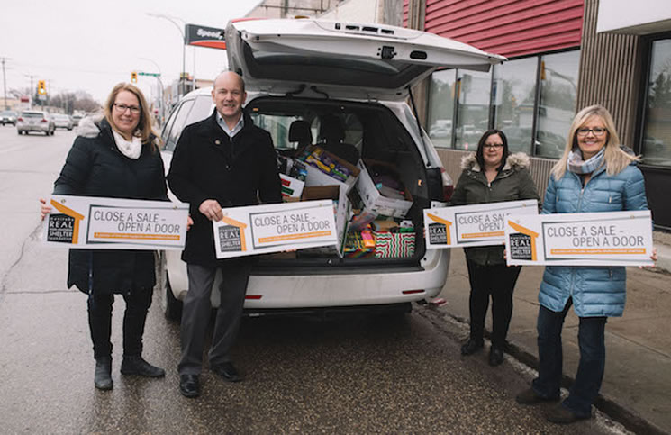 Collecting donations for the Care-a-Van charity drive, from left: MREA director of communications Kim Gandier, MREA Shelter Foundation governor Roger Burns, MREA operations co-ordinator Pamela Moat and MREA director of operations Jill Johnston.