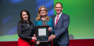 Shanan Spencer-Brown, left, executive director, Royal LePage Shelter Foundation and Phil Soper, president and CEO, Royal LePage receive the 2018 Association of Fundraising Professionals Philanthropy Award for Outstanding Corporation from Jen MacRae, senior program manager, community relations, Great-West Life, London Life and Canada Life.
