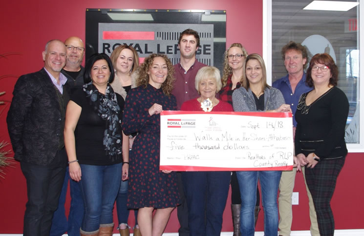 Presenting a $5,000 donation to their local Walk a Mile in Her Shoes event are Royal LePage County professionals, from left: broker/owner Trevor Yurchak, Brian Rabin, Shahira Bury, Ashley Weymouth, Harmony Lamoureux, Alex Weinberger, Betty Kanuga, RaDell Bennett-Chrusch, Jennifer Miller, Dwight Chernish and associate broker/owner Tamara Yurchak.