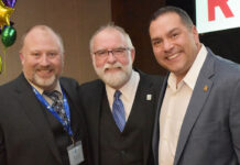 From left: Dwayne Hayes, 2014 Dave Hawkins Award recipient and NBREA education officer; Paul Burns; and Jason Stephen, president of CREA.