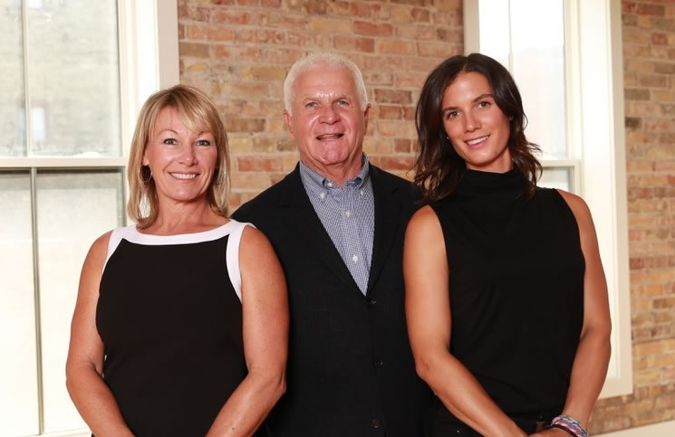 Company president Jane Klugman, left, with John Whitney and Ginger Whitney.