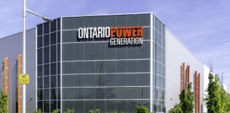 Courtice, Ontario, Canada-June 09, 2019: Sign of Ontario Power Generation on the building at Darlington Energy Complex in Courtice, Ontario, the building supporting refurbishment reactors.