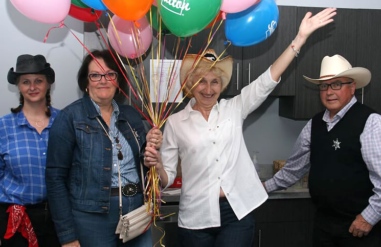 Several Sutton team members gathered early in the morning to blow up the balloons for the Stampede barbecue, including, from left, Melody Zondag, Valerie ter Mors, Zorka Domazet and Doc Watson.