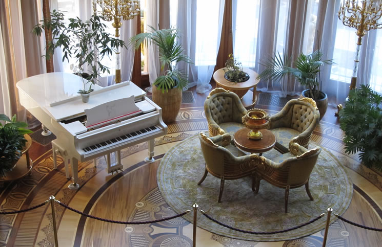 The piano in the living room. Note the inlaid wood floor.