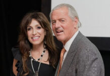 Rina DiRisio receives the award from John Brian Losh, chairman of Luxury Real Estate.