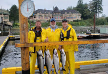 Weighing in the day's catch at the Royal LePage Broker/Owner Fishing for Shelter event in Campbell, River B.C., from left: Andrew Wildeboer, Rob Wildeboer and Jason Ralph.