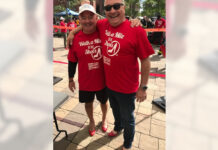 Royal LePage Gardiner Realty broker/owner Lincoln Thompson poses with Walk a Mile in Her Shoes organizer Georges Gaucher from Royal LePage Village in Montreal.