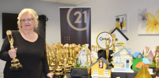 Suzanne Robinson with some of her sales awards.