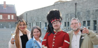 Dylan-Mae Caron, Karen Catuogno and Stan Sheer from Abbott Properties in Rhode Island pose with a member of the 78th Highlanders at the Halifax Citadel National Historic Site during the recent NSAR-sponsored trade mission.